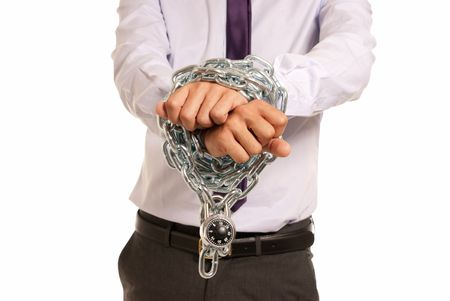 Businessman hands fettered with chain and padlock, job slave symbol, isolated on white background Stock Photo - 7362120