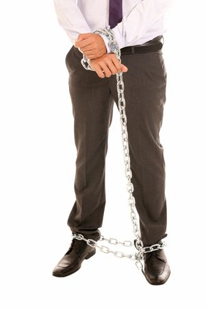 hardly: Businessman hands and legs fettered with chain, job slave symbol, isolated on white background Stock Photo