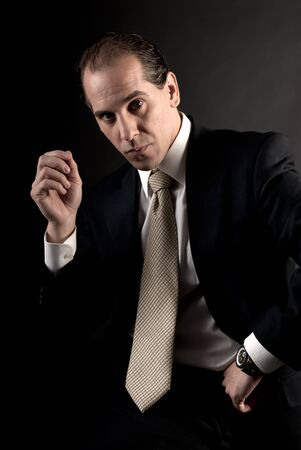 adult businessman welldressed serious sitting looking at camera. Stock Photo - 7501029
