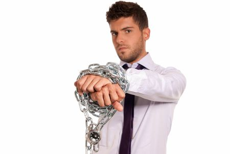 Businessman hands fettered with chain and padlock, job slave symbol, isolated on white background photo