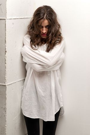 Young insane woman with straitjacket standing looking at camera  Stock Photo - 8084989
