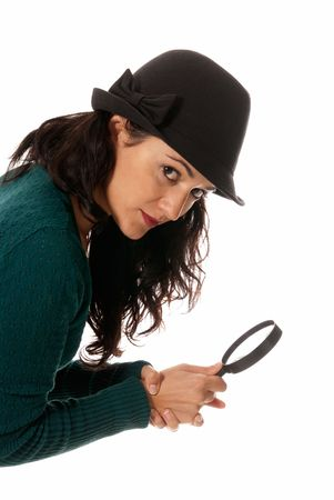 young woman with magnifier glass and hat looking to camera isolated on white background photo