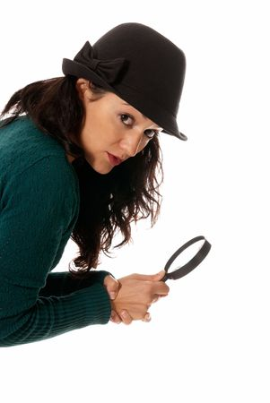 sagacious: young woman with magnifier glass and hat looking to camera isolated on white background