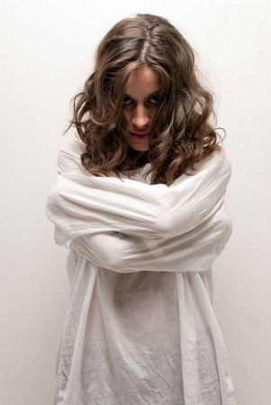 Young insane woman with straitjacket standing looking at camera  Stock Photo - 8201576