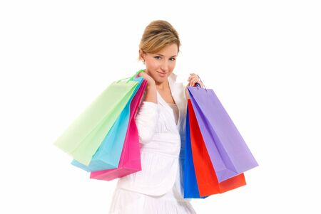 Young woman with shopping bags standing isolated on white background photo