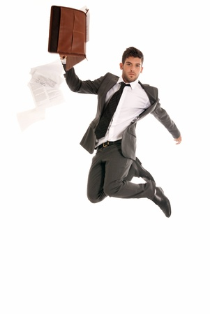 Young businessman jumping with open briefcase falling papers copy-space isolated on white background. photo
