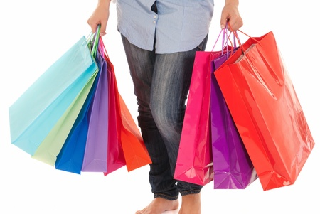 Unrecognizable woman with shopping bags isolated on white background photo