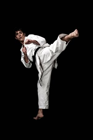 Karate male fighter young high contrast on black background