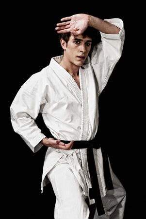 Karate male fighter young high contrast on black background photo