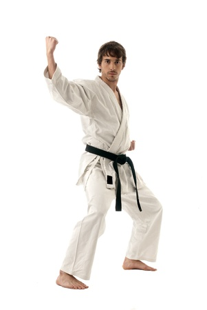 karate kick: Karate male fighter young isolated on white background