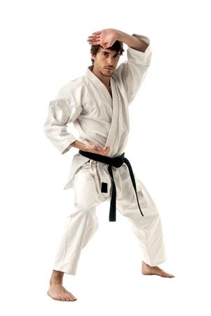 artes marciales: J�venes de caza masculino de Karate aisladas sobre fondo blanco
