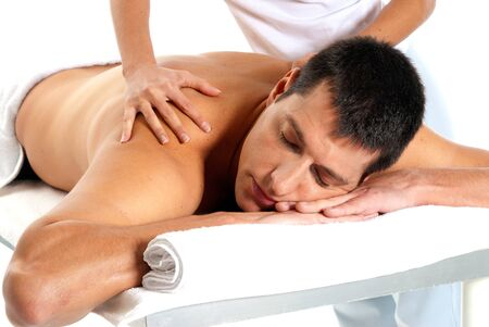 massage: Man receiving massage relax treatment close-up from female hands  Stock Photo