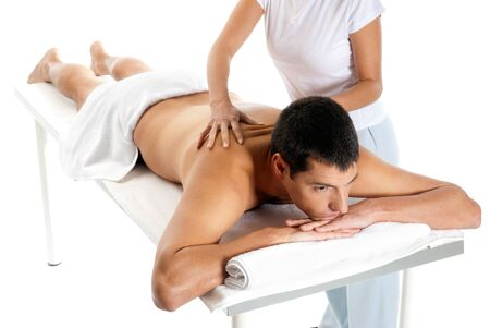 Man receiving massage relax treatment from female hands  Stock Photo