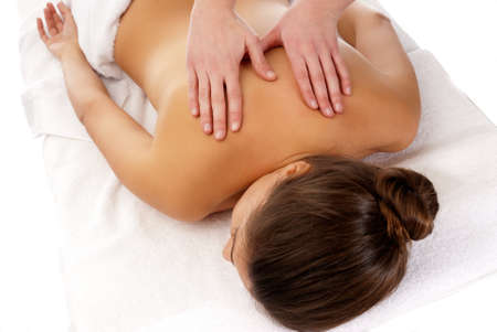 woman receiving massage relax treatment close-up from male hands photo