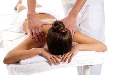 woman receiving massage relax treatment close-up from male hands