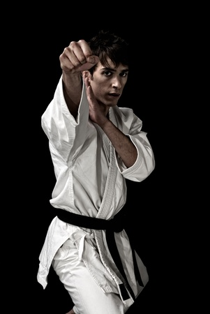 High Contrast karate male fighter on black background. On AdobeRGB.
