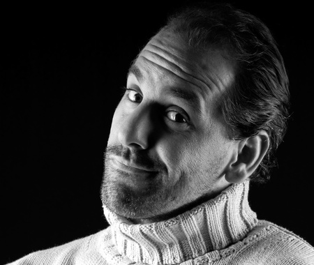 Adult man portrait cheerful wink expression on black and white photo