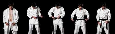 Karate male fighter dressing kimono secuence high contrast composite secuence on black background.