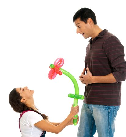 Young couple gift baloon flower valentine�s day isolated on white background photo