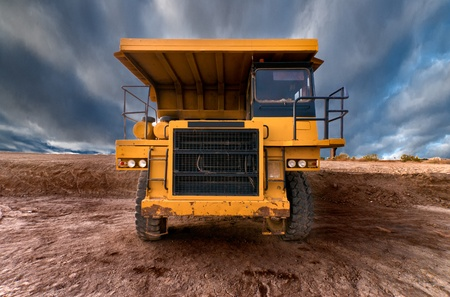 sand quarry: Huge auto-dump yellow mining truck  Stock Photo