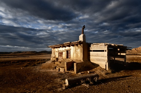 autum: Abandoned house landscape dramatic cloud sky
