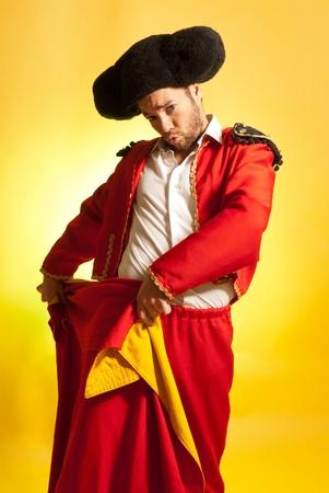 overburden: Bullfighter courage red yellow humor spanish colors
