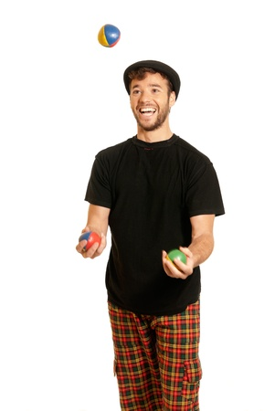 Young man juggling isolated on white background photo