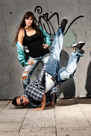 hip hop dance: Young urban couple dancers hip hop dancing urban scene