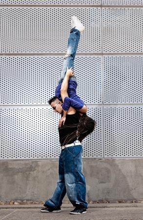 Young urban couple dancers hip hop dancing urban scene photo