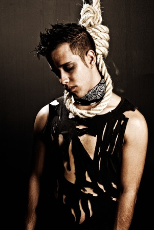 Young man hanged grunge style dark dead concept photo