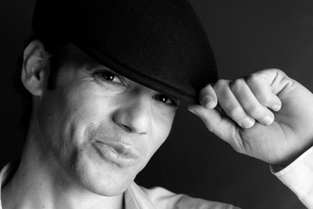 Handsome man portrait with hat black and white photo