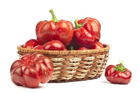 dominant color: Red pepper in basket on white background