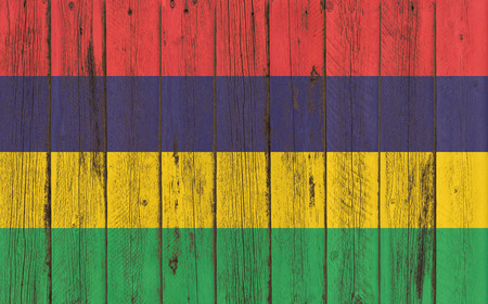 flagged: mauritius flag on old wood texture background - old wood background - Text Stock Photo