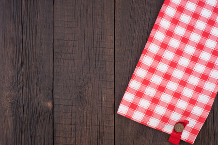 menue: Rustic wooden boards with a red checkered tablecloth. Top view. Stock Photo