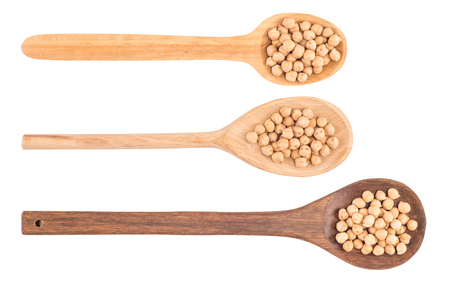 uncooked chickpeas in wooden spoon on white background. Top view. Stock Photo