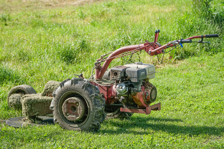 outside machines: Old Lawn mower use oil in the garden Stock Photo