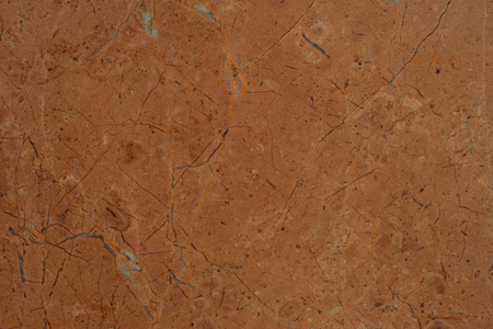 seamless tile: brown marble stone seamless background pattern or texture