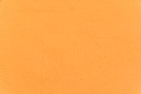 stucco: Stucco Wall - Orange Yellow stucco textured wall.