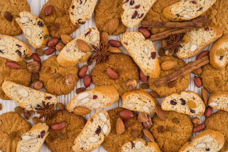 Cookies with almonds and raisins on the old wooden table. Top view. Stock Photo