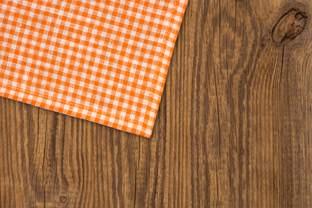 menue: Rustic wooden boards with a orange checkered tablecloth