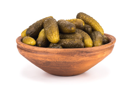 lay forward: Pickles in decorative cup or bowl. Selective focus. Stock Photo