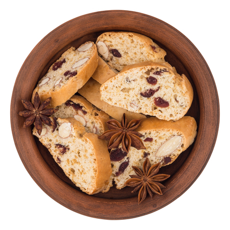 wholegrain: Cookies with raisins in a ceramic plate. Isolated on white background. Top view.