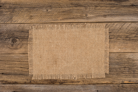 showy: Texture of the old burlap and wood. Top view.