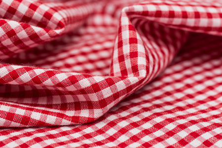 Checkered tablecloth kitchen selective focus. the white and red checkered background Stock Photo