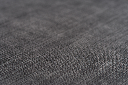 Gray fabric texture. Abstract background, empty template. Selective focus.