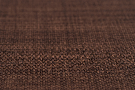 Brown fabric texture. Abstract background, empty template. Selective focus. Stock Photo