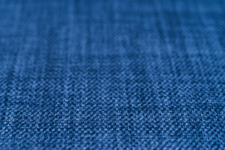Blue fabric texture. Abstract background, empty template. Selective focus.