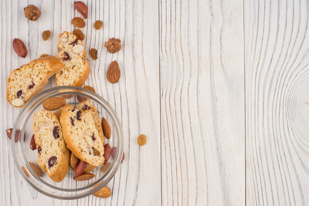 Cookies with almonds and raisins on the old wooden table. Top view. Banco de Imagens
