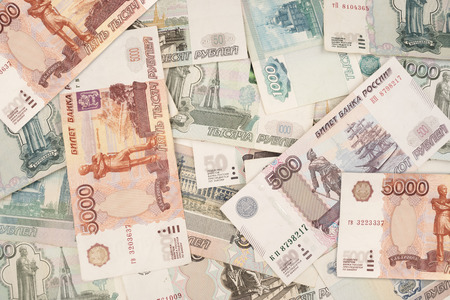Russian banknotes in denominations of 1000, 500, 100 and 5000 rubles close-up, top view