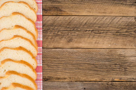 Sliced bread on an old wooden table. Top view.